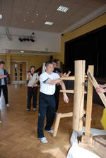 photo Master Tse teaching the Wooden Dummy